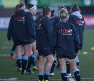 Cardiff blues womens team sporting their wet weather kit as part of sponsorship package from CJCH solicitors